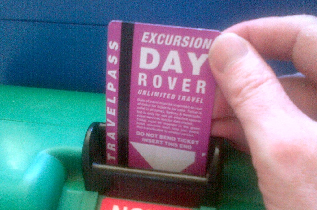 SETS Excursion Day Rover ticket being inserted in green machine